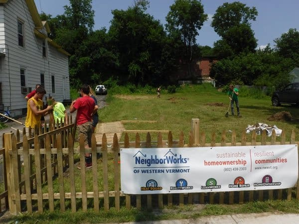 NeighborWorks of Western Vermont volunteers installing a fence in Rutland